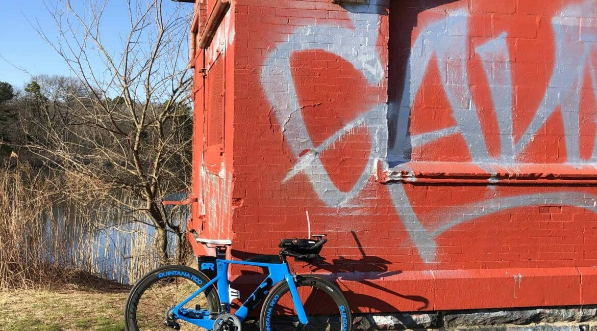 QR bike leaning against a shed