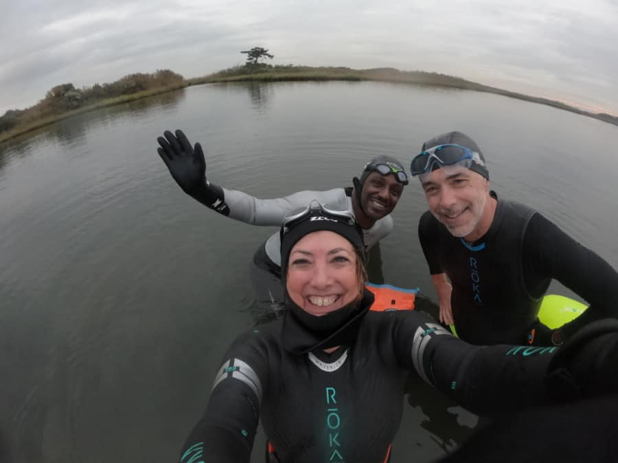 In November, three swimmers are still swimming open water