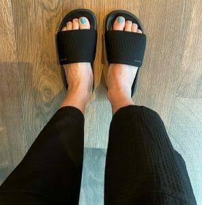 Hilary Topper wearing Skechers GoWalk Slides for Recovery